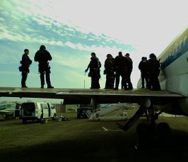 SWAT team breach of airliner